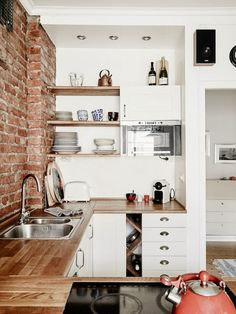 Swedish Kitchen With Exposed Brick Wall / Stadshem