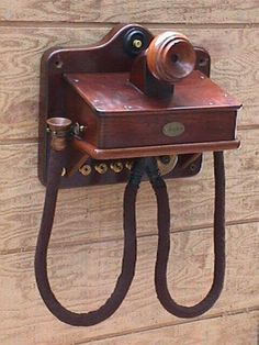1880 Gower Bell Telephone     This set was the first type of telephone used in Spain, Japan, England and other countries in Europe. It replaced the Morse Telegraph and preceded the hand-cranked magneto type telephone.
