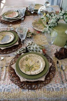 One of the things that makes this tablescape interesting, besides the sage, brown, and white, the unusual placemats, and attractive magnolia plates, is the quilt used as a tablecloth. With that, you don't need much else for decoration, and they kept it nicely simple.