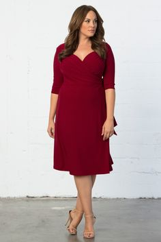 94003ec732ab4 Our classic plus size Sweetheart Knit Wrap Dress in a fiery red is on sale  now. Kiyonna Clothing