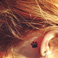 paw print tattoo... Gotta get one of these sometime!