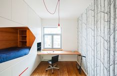 Belgium-based Van Staeyen Interieur Architecten designed a wall of cabinets with a sleeping nook for a child's bedroom.