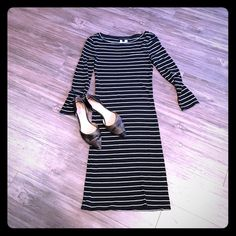 3/4 sleeve striped jersey knit dress BCBG amazingly comfortable dress. Looks killer with a jean jacket and sneakers. So so cute. Noticed a tiny snag as I was laying it out but nothing I've ever noticed before (see pic 3). Black and white and in great shape. BCBGMaxAzria Dresses