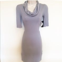 NWT gray tunic or dress! Super cute coupled with leggings or worn as a dress! Stretchy material gives it a nice, comfortable fit. Brand new with tags! Tops Tunics