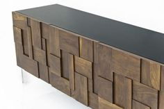 Get lost in the maze that is the Kubist Credenza! Featuring a sleek gloss black frame and solid walnut hand-cut blocks, that are also positioned all by hand, and then nestled securely on top of ultra