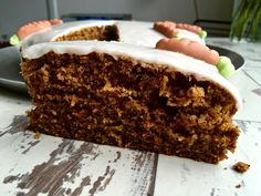 This carrot cake recipe wonderfully juicy and fluffy. The cake is topped with lemon icing and marzipan carrots to make it a delicious family treat.
