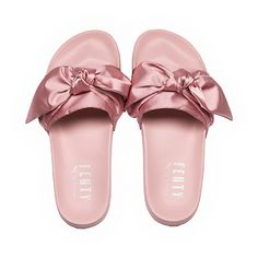 <p>Influenced by the luxurious Parisian days of Marie-Antoinette, the Bow Slide by FENTY takes the classic soccer slide up a bunch of notches. A beautiful satin bow adorns the slide strap, with a satin foam backing for comfort. Sure to be a hit for those who loved the Fur Slides from 2016.</p><p>Features</p><ul><li>Satin Bow constructed on strap</li><li>Satin Foam Backing</li><li>FENTY PUMA BY RIHANNA emblazoned ...