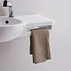 Tiny cloakroom sink - imagine a Glass Metro Tile splashback in one of our exclusive UK colours ...www.too-jazzy.com