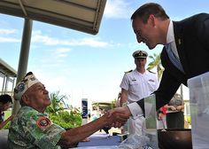 Peter MacKay, Canadian Minister of National Defense, meets a Pearl Harbor attack survivor, Herb Weatherwax at the Arizona Memorial Museum.