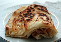 """Gozleme or Sac Boregi is a traditional Turkish meal. Its name comes from the Turkish word """"goz"""" which means """"eye"""". It is made of kneaded dough rolled into very thin crusts, just like a pancake and then sprinkled with different fillings which depends on tasters' preferences: - spinach and feta cheese - spinach, feta cheese and minced meat - spinach, feta cheese and eggs - seafood - eggs - minced meat - yellow cheese - potatoes - mushrooms - roasted eggplant If you want to prepare gozleme at…"""