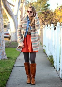 Break out a red skirt with lots of cozy layers and flat riding boots. http://www.thestyleup.com/style/56c5z