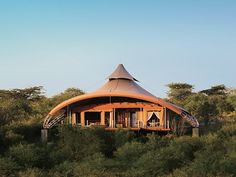 Travel to Kenya and stay at the Mahali Mzuri safari camp.