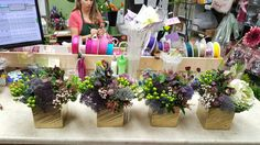 Purple and white flower arrangements for wedding and events