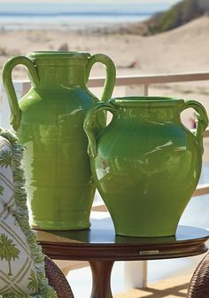Lend an artisanal touch to your home or patio with the Libra Vase with Handles. Meticulously handcrafted in Italy, the terracotta vase is finished with a gorgeous hand-applied green finish and features darker accents for a vintage feel