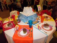 table settings for flip flop beach theme party - the sandwiches are cut from flip flop cookie cutter our of brown bread - straps are made of Twizzlers cut lengthwise - but leave one end together.  Sand castle is moon sand - stayed together for transport in car for more than 10 miles.