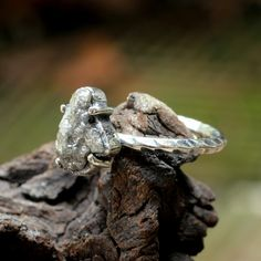 Sterling silver hand textured ring with genuine dark rough diamond