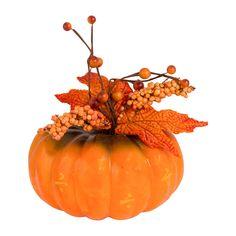 Deze pompoen met decoratie zorgt voor kleur in je huis tijdens de herfst!