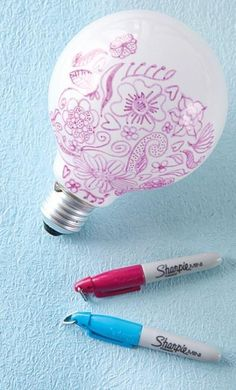 GOOD IDEA: Use a marker that can write on glass, such as a Sharpie pen, to draw on bulbs. The bulb will look pretty, plus it will make patterns on the wall when the light is on.