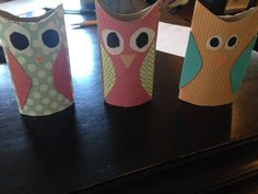 cute diy owls to make with a simple toilet paper roll. cut the top off and glue the scrapbook paper on it! && there you go!