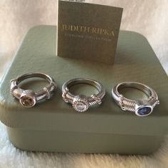 Judith Ripka-3 Heavy Sterling Silver Gem Rings Judith Ripka Set of 3  Heavy Sterling Silver Gemstone Rings. Diamonique, Citrine and I believe it's Iolite. Can be worn separate or stacked. Size 7 but I believe they can be sized. Worn once. Perfect condition.  Made in Thailand. Judith Ripka Jewelry Rings