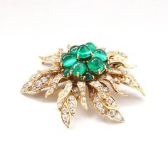 1960s Cartier Emerald and Diamond Flower Brooch   From a unique collection of vintage brooches at https://www.1stdibs.com/jewelry/brooches/brooches/