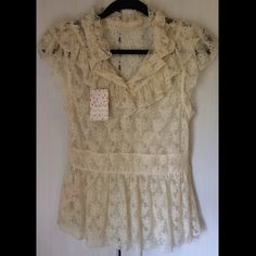 """Elegant Lace Blouse By Free People.  This victorian-style, all lace top is beautifully made with added lace ruffle detail on both the front and the back.  The two seams that connect the lace on the waistline are made with a stretchy elastic band that comfortably hugs your torso and makes for a flattering, fitted piece.  Features:  100% Nylon;  Machine wash.  Comes with an extra pearl button attached on the inside of the shirt next to """"care"""" label.  Never worn.  NWT Free People Tops Blouses"""