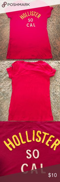 ⚡️Hollister⚡️Short Sleeves Hot Pink Graphic Tee This is hot pink with white and yellow writing. My camera makes it look more red than pink, but in person it's definitely hot pink. No flaws or defects. Worn once.   PRICE FIRM. 10% off bundles of 4 or more. No trades, sorry!  Smoke free home, but have two furbabies. 1 Hollister Tops Tees - Short Sleeve