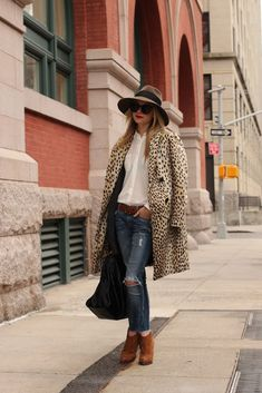 great casual weekend outfit - hat, longer coat, button up, jeans and booties