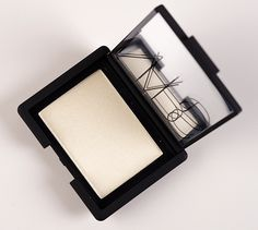 NARS Albatross Highlighter. This is the best highlighting powder I've ever found!!! A little goes a long way, especially if you have pale skin, don't use much, it will look like you've covered your face with baby powder. It's great for under the eyes to the temple, bridge of nose, chin, & forehead. Looks like you're glowing!! A must have for any makeup junkie.