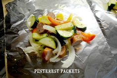 Foil packets for the grill with smoked sausage, bell peppers, little potatos and red onion...SO GOOD!