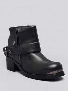 Black, leather ankle boots featuring a fold over flap around the shaft with an adjustable side buckle and snap closure