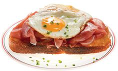 This hearty German sandwich on thick-sliced country bread calls on a classic combination: cured ham and fried eggs.