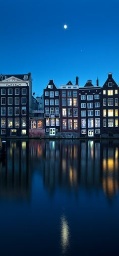Moon over the River Amstel in Amsterdam, Netherlands • photo: Artem Savateev on 500px