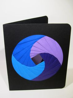 Iris folding...looks like the shutter in a camera.