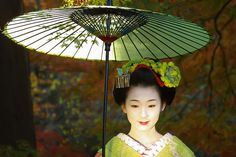 """""""Remember, geisha are not courtesans. We create another secret world, a place only of beauty. The very word """"geisha"""" means artist and to be a. Japanese Geisha, Japanese Paper, Japanese Kimono, Green Kimono, Memoirs Of A Geisha, Paper Umbrellas, Parasols, Matcha Green Tea, Color Of Life"""