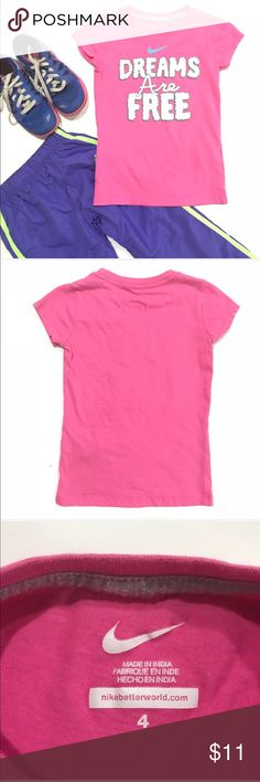 "Nike girls pink short sleeve tee shirt •Nike short sleeve pink tee shirt with ""Dreams are Free"" in white on the front with a plain back •EUC, no stains or holes  ••I am a: Posh Ambassador, top 10% seller, top rated seller, Posh mentor & ship same day/next day!  ⭐️❤️FREE Matching hair accessory with purchase!❤️⭐️ •Comes from smoke & pet free home •Browse my closet for dozen of amazing designers such as.. tucker + Tate, Tea Collection, Mini Boden, UGG, GAP, Juicy Couture, Lululemon & many…"