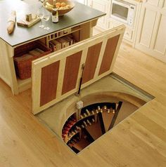 I'm not sure I'd do this for a kitchen wine cellar, but I do love the idea of a trap door leading to a spiral staircase. So much more interesting than your typical trap door staircase, which slides out from the attic.