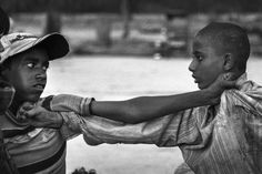 """Two """"glue kids"""" fighting in Cotton Market, near Jama Masjid mosque, where many Muslim street children hang around. Fights and arguments, among each other or with peddlers, are not uncommon, mostly stemming from money, drugs, food or honor."""