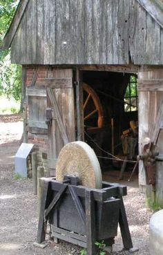 – BARN – vintage early american barn commonly used for storing farm equipment, storage of harvested crops, or providing shelter for livestock with an old stone grinder and vice. Country Barns, Old Barns, Country Life, Country Living, Old Tools, Antique Tools, La Forge, Blacksmith Shop, Farm Tools