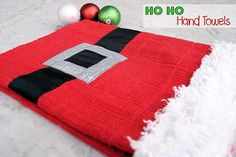 Santa Suit Hand Towels {frugal christmas presents} Ho ho ho! This jolly Santa Claus dish towel is festive and fabulous! A red hand towel, ribbon, fur trim and a… Santa Crafts, Christmas Projects, Holiday Crafts, Holiday Fun, Christmas Ideas, Christmas Decorations, Frugal Christmas, Noel Christmas, Winter Christmas