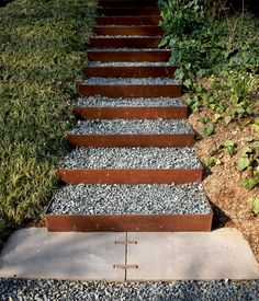 The stairs going up the knoll to a roof garden and to an Anchorage, Alaska, house's second-level entrance are made from Cor-Ten steel risers (which develop a rich, rusted patina) and are filled with gravel in order to create a nonslip surface that drains well. The steel and steelwork is by Virginia Industrial. Read the full article here.