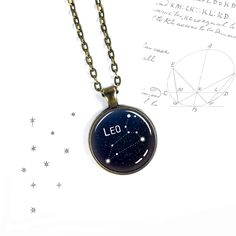 - DESCRIPTION - THE DETAILS - SHIPPING - This constellation necklace has several choices – font, chain style, keyring, silver or bronze. Make it yours. The image is sealed with a crystal clear glass d