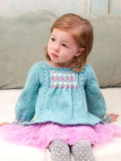 Free Pattern - With intricate cable details, this pretty #knit sweater is a great addition to kids' wardrobes