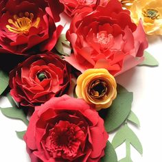 Paper Flower Wall, centerpieces, escort cards... Available in almost any color special orders welcome www.paperflora.com