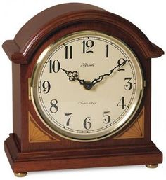 """Windfall Barrister style clock by Hermle in cherry finish with corner inlays. Dual chime quartz movement plays 1/2 hour Bim - Bam or 4/4 Westminster chime with volume control and night shut-off.  Measures: H 8-1/2"""" x W 7-1/2"""" x D 4-1/2""""   Three year manufacturer's warranty at http://www.theisenclock.com/mantel_clock.html"""