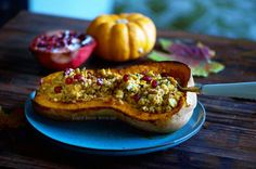 Smoky flavoured roasted butternut squash filled with freekeh, pine nuts and feta cheese and topped with pomegranate seeds. A delicious comfort winter recipe Roasted Butternut Squash, Pomegranate Seeds, Winter Food, Fall Recipes, Feta, Zucchini, Vegetarian Recipes, Autumn, Vegetables