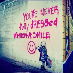 Street Art. Never fully dressed without a smile quote.