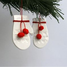 Pair of Pompom Mitten Decorations, porcelain and red wool Christmas ornaments