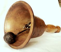 School bell.  This was rung to call us in from recess.