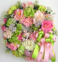 """The wreath is embellished with beautiful pink/white Peonies. pink Roses,lime green Roses, white Baby Breaths, and pink/white/lime green Hydrangeas. The wreath is accented with a very cute pink Bird in the middle of the wreath. I finish the wreath with a pink/lime green Ribbon Bow.   The wreath measures from tip to tip at 22"""" (L) x 22"""" (W) x 7""""(D)."""